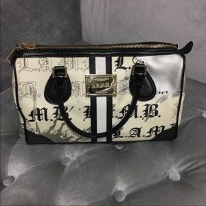 Authentic lamb handbag comes with the dust bag